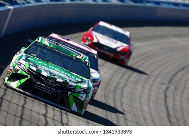 March 17, 2019 - Fontana, California, USA: Kyle Busch (18) races down the front stretch for the Auto Club 400 at Auto Club Speedway in Fontana, California.
