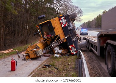 March 17, 2020, Riga, Latvia: car accident on a road, mobile crane after falling from trailer, transportation background