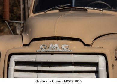March 18th, 2019 [USA] - Lolo, Id : Old beige GMC pickup truck sitting alongside the Lochsa River off of Hwy US 12 - Image