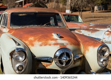 March 18th, 2019 [USA] - Lolo, Id : Old Studebaker car sitting alongside the Lochsa River off of Hwy US 12 - Image