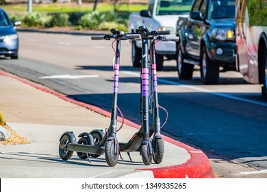 March 19, 2019 San Diego / CA / USA - Lyft electric scooters parked on a sidewalk