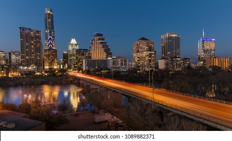 MARCH 2, 2018, AUSTIN, TEXAS - Austin Cityscape Evening Skyline with skyscrapers down Congress Avenue Bridge over Colorado River