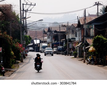 March 20, 2015: low traffic on local road street in a small town in northern THAILAND showing easy and slow life country living style in old vintage surrounding cute little province in THAILAND