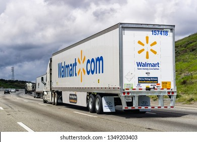 March 20, 2019 Los Angeles / CA / USA - Walmart truck driving on the interstate among hills on a cloudy day