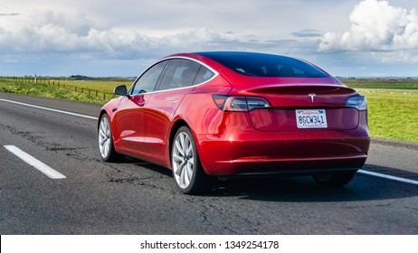 March 20, 2019 Los Angeles / CA / USA - Red Tesla Model 3 driving on the freeway