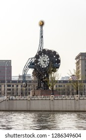 March 2014 - Tianjin, China - the big clock near the train station in Tianjin, China, seen from across the Haihe river