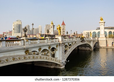 March 2014 - Tianjin, China - European style bridge with golden statues crossing the Haihe River in the city center of Tianjin, China