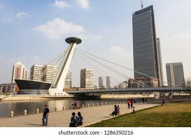 March 2014 - Tianjin, China - People walking along the Haihe river in Tianjin