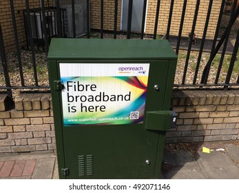 March 2015, a broadband street cabinet belonging to BT's Openreach division displays a poster advertising the availability of fibre based broadband services