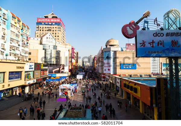 March 2016 - Qingdao, China - Taidong walking street, the most famous shopping street of Qingdao, home of a crowded night market. This street is also famous for the mural paintings on buildings