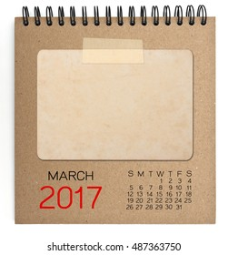 March 2017 calendar on brown notebook with old blank photo