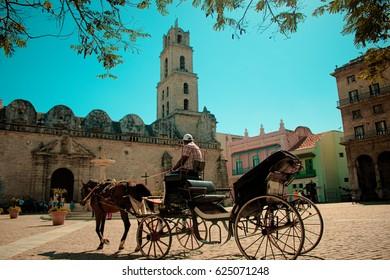 March 2017 - Havana, Cuba; A horse-drawn carriage in front of the Basilica Menor de San Francisco de Asis in Old Havana. Havana is the capital of Cuba.