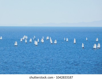 March 2018. Sailboats in a blue sea, in the bay of Varkiza, in Attica, Greece