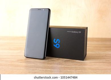 March 2018. Samsung Galaxy S9 close-up on the table. A new smartphone from the Samsung company and a box from it, is on a wooden surface.