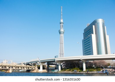 March 2018 - Tokyo, JAPAN: Beautiful view of the Sumida district of Tokyo from the Sumida river, Japan. Tokyo Sky Tree, famous tourist spot is located behind.