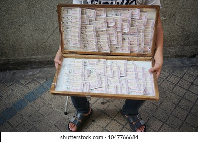 March ,2018 : unidentified woman selling thai lottery at market , Bangkok,Thailand