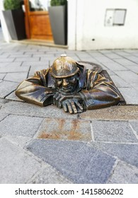 March 2019. Beautiful bronze statue in Bratislava, Slovakia. Cumil : Man at work (literal translation of the word Čumil is the watcher). Sightseing element, beautiful art. Close up. Communist worker.