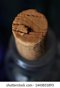 March 2019, Lancaster, CA: A close-up of a cork in an old, dusty collectible bottle.