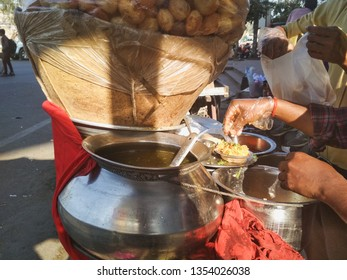 March 2019, New Delhi , Man making famous street food of India gol gappa on the streets of Kirti Nagar