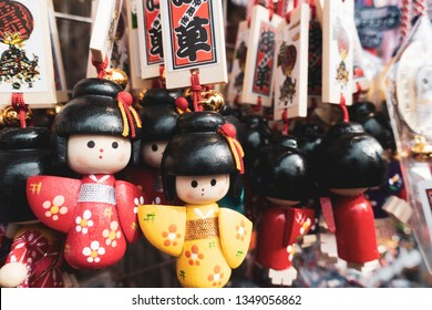 March 2019 - Tokyo, Japan: Japanese wooden doll, famous souvenir sold at Asakusa Sensoji Temple.