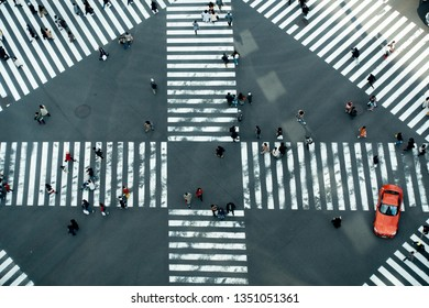 March 2019 - Tokyo, JAPAN: Overhead view pedestrian passing through the Ginza Sukiyabashi crossing.