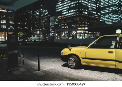 March 2019 - Tokyo, JAPAN: A taxi stopping in front of taxi stand of Tokyo Station, the biggest and busiest railway station in Japan.