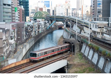 March 2019 - Tokyo, Japan:  Train junction near Ochanomizu Railway Station and River Kanda in Tokyo, with Marunouchi Subway Line and Sobu Railway Line passing at the same time. Metro system of Tokyo.