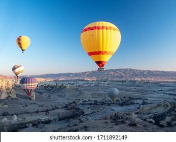 March 2020: Hot air balloon flying over spectacular Cappadocia, Turkey