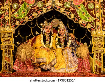 march 2021 mathura,india. Young actors representing Krishna and Radha marriage on a stage with selective focus on subject and added noise and grains.