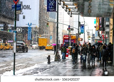 March 21, 2018: Moving around the Port Authority bus terminal in Manhattan on a heavy blizzard hits New York City in the United States