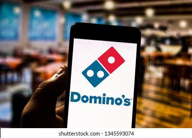 March 21, 2019, Brazil. Domino's Pizza logo on the screen of the mobile device. Domino's is a pizzeria based pizza company. It is currently the largest pizza delivery network in the world.