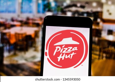 March 21, 2019, Brazil. Pizza Hut logo on the screen of the mobile device. Pizza Hut is a chain of restaurants and franchises specializing in pizzas and pastas.