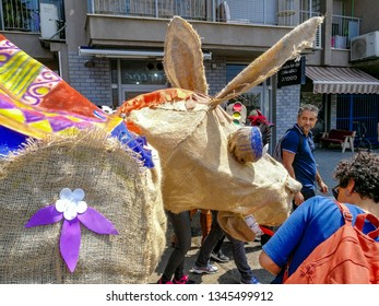March 21, 2019. Tel Aviv. District FLORENTIN. Festive procession dedicated to Purim Ad-lo-Yad.  Giant puppets inspired by the work of the famous Israeli painter, sculptor and author Nahum Gutman.