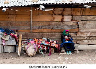 March 21, 2019: Tibetan woman and her small stall. Shangri La, Yunnan, China