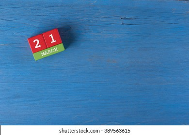 March 21, Cube calendar on wooden surface with copy space