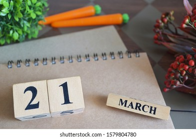 March 21, Save the date with number cube design for background.