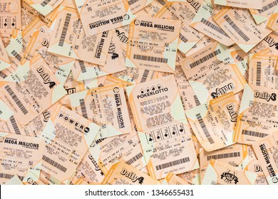 March 22. 2018. Detroit, Michigan, USA. Used Mega Millions, FANTASY 5, POWERBALL, DAILY 4 American Lottery Game Ticket Background. Selective focus.