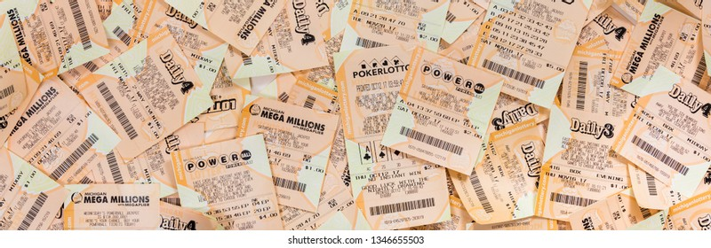 March 22. 2018. Detroit, Michigan, USA. Used Mega Millions, FANTASY 5, POWERBALL, DAILY 4 American Lottery Game Ticket Background. Selective focus. Panoramic image. Selective focus.