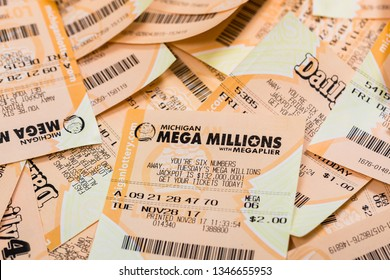 March 22. 2018. Detroit, Michigan, USA. Used Mega Millions American Lottery Game Ticket Background. Selective focus.