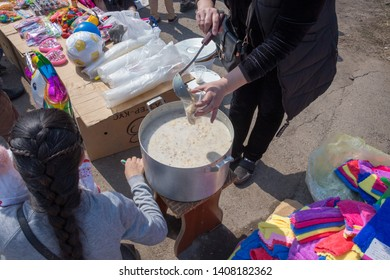 """March 22, 2019 Almaty, Kazakhstan. Distribution of free national dishes """"LEATHER"""" during the celebration of the Nauryz holiday"""