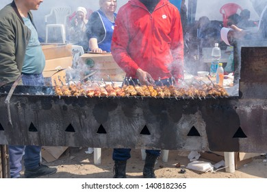 March 22, 2019 Almaty, Kazakhstan. Distribution of free national kebabs during the celebration of the holiday Nauryz