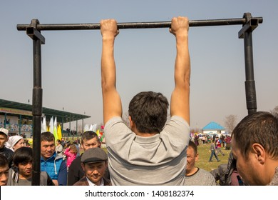 March 22, 2019 Almaty, Kazakhstan. Sports competitions in the horizontal bar during the celebration of the holiday Nauryz