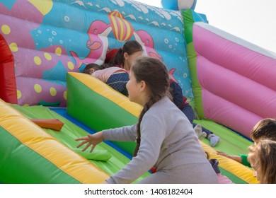 March 22, 2019 Almaty, Kazakhstan. Children playing during the celebration of Nauryz holiday
