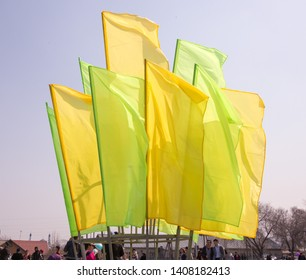 March 22, 2019 Almaty, Kazakhstan. Decorative colored flags stand during the celebration of the Nauryz holiday