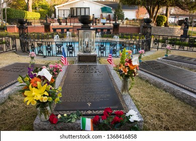 MARCH 22, 2019 - MEMPHIS, TENNESSEE, USA:   Elvis Presley's grave in the Meditation Garden at Graceland in Memphis, Tennessee.