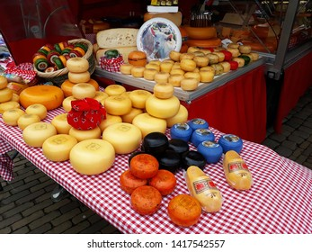 March, 23, 2019, Gouda, The Netherlands. Traditional Dutch cheeses for sale on a market stall in Gouda.