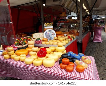 March, 23, 2019, Gouda, The Netherlands. Traditional Dutch cheeses for sale on a market stall in Gauda.