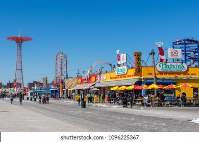 March 24, 2018: Iconic Boardwalk with Parachute Drop and Nathans Hot Dogs in Coney Island, Brooklyn