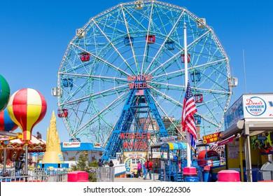 March 24, 2018: Iconic Wonder Wheel amusement ride on boardwalk in Coney Island, Brooklyn