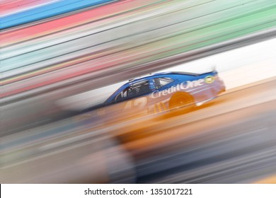 March 24, 2019 - Martinsville, Virginia, USA:  Kyle Larson (42) races down the back stretch during  the STP 500 at Martinsville Speedway in Martinsville, Virginia.